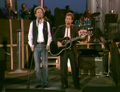 Watch and share Simon & Garfunkel - Me & Julio Down By The Schoolyard (from The Concert In Central Park) GIFs on Gfycat