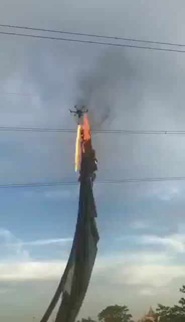 Watch and share Drone Equipped With A Flamethrower Clearing Debris From A Power Line GIFs by tothetenthpower on Gfycat