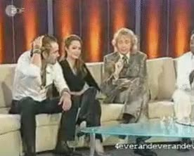 Watch and share Angelina Jolie Foot Humping Colin Under Table At Interview GIFs on Gfycat