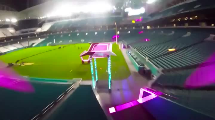 Drone racing in a football stadium GIFs