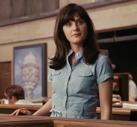 Watch and share Zooey Deschanel GIFs and Side Glance GIFs on Gfycat