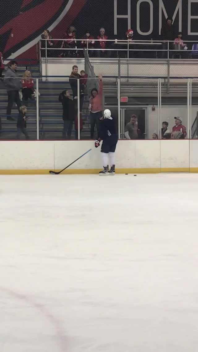 Watch and share Madison-bowey-tries-to-toss-puck GIFs on Gfycat