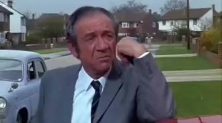 Watch and share Sid James Laugh GIFs on Gfycat