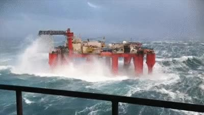Watch and share Huge Waves Crash Against Swaying North Sea Oil Rig GIFs on Gfycat