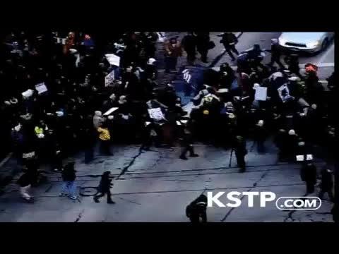 Driver runs over protesters in Minneapolis GIFs