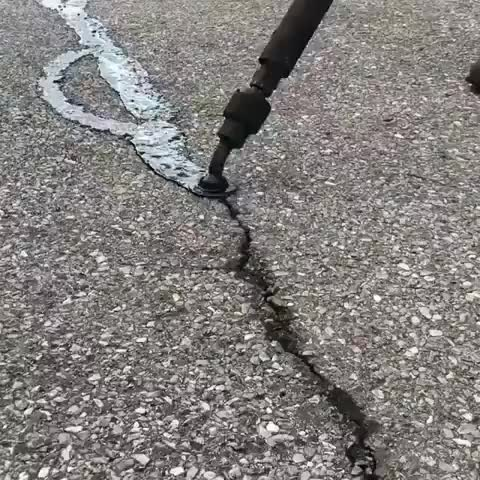 interesting, satisfying, filling in the cracks on the parking lot w asphalt GIFs