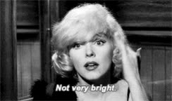 blocking out the haters, duh, dumb, funny gif, haters, idiot, marilyn Monroe, marilyn monroe, not very bright, some like it hot, stop bullying, stupid, Not Very Bright GIFs