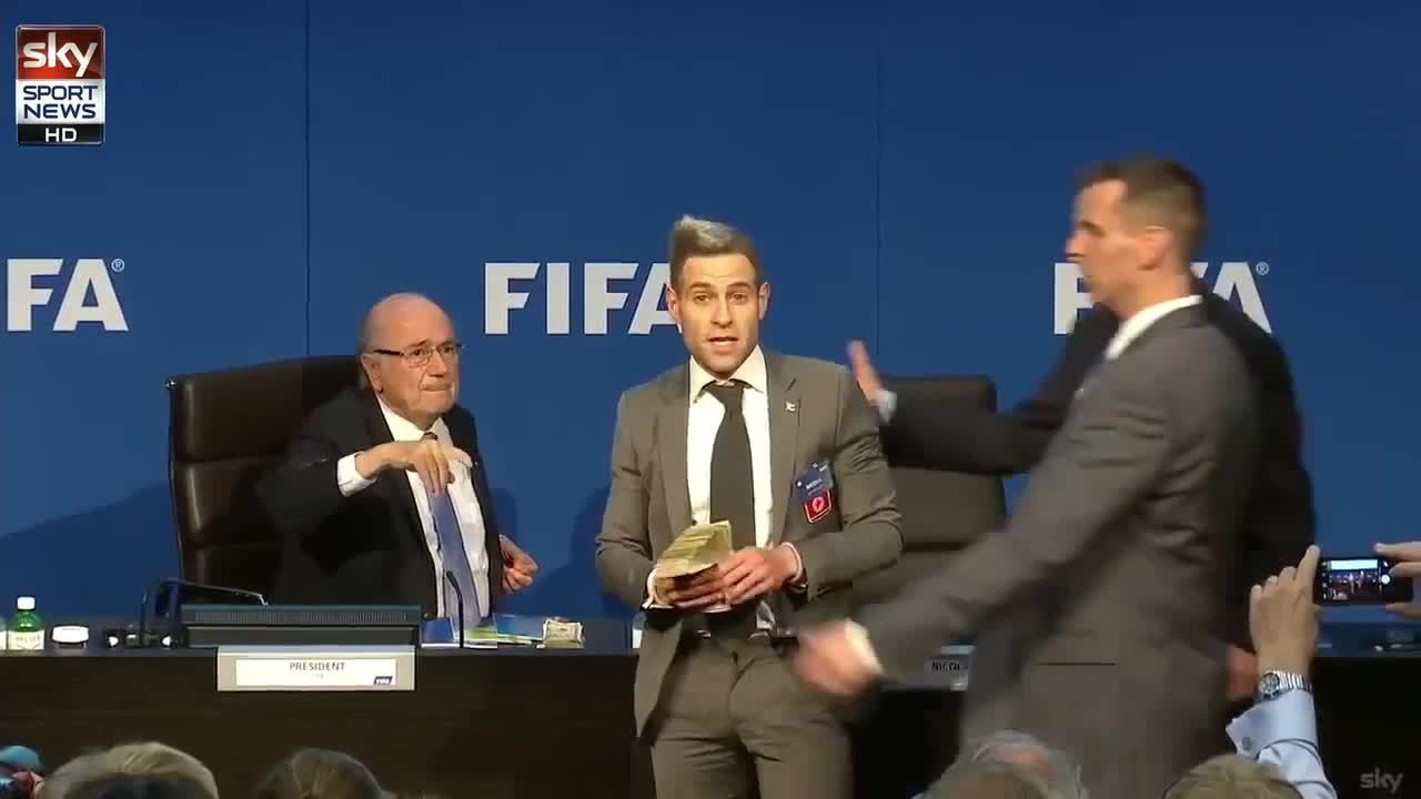 Blatter gets showered in american currency GIFs