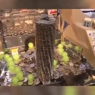Watch and share Lucky Guy Win This Coin Tower GIFs on Gfycat