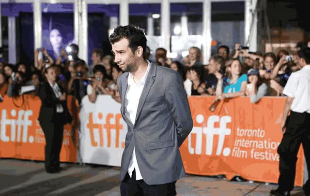 Watch and share TIFF GIF: Jay Baruchel's Awkwardly Cute Red Carpet Poses GIFs on Gfycat