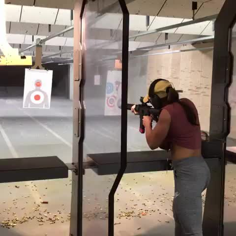 She got guns and she knows how to use them GIFs
