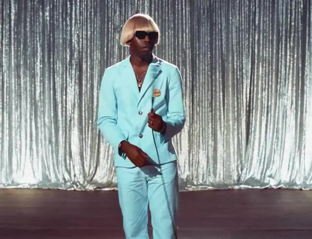 Tyler the creator - EARFQUAKE whatever waiting wait tyler the sunglasses suit spin pff microphone mic late creator cable boring bored blue around EARFQUAKE trending curated GIF
