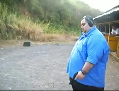 Watch and share Fat Guy Shooting Gun GIFs on Gfycat