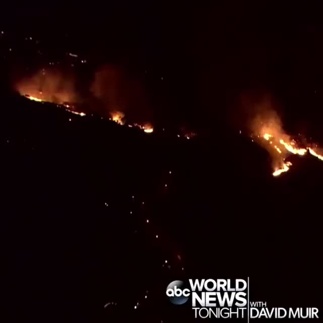 WorldNewsTonight, abc, aerial, cali, california, fire, losangeles, westhills, wildfire, woolseyfire, MONSTER BLAZE: New aerials show the bright yellow flames of the Woolsey Fire burning in West Hills, California, as authorities issue evacuat GIFs