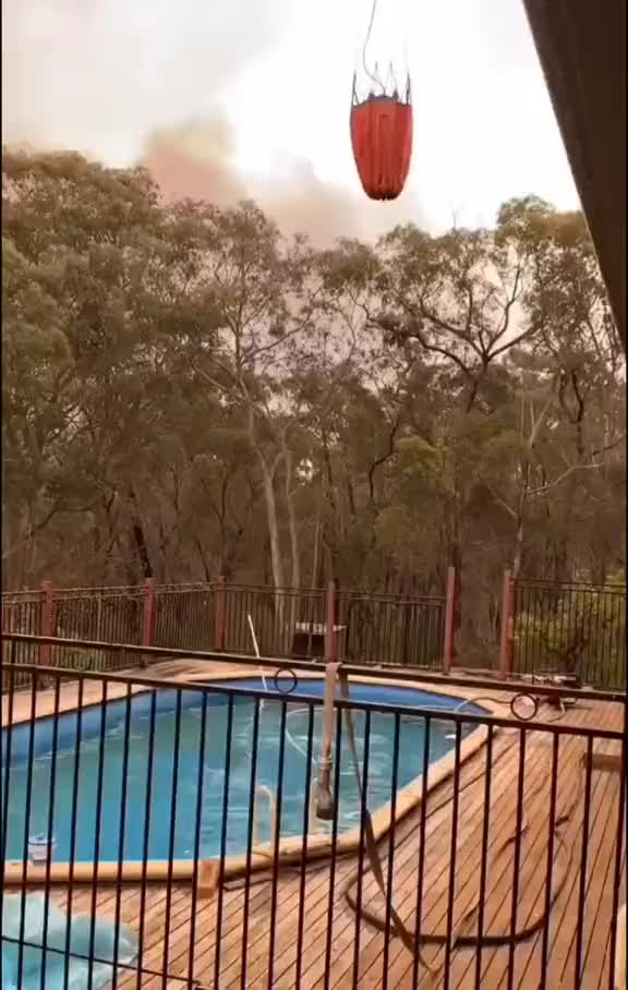 Watch and share Fire Fighting Chopper Lowers Its Bucket Into A Backyard Swimming Pool GIFs by hellsjuggernaut on Gfycat