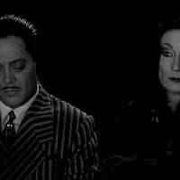 Watch and share Gomez And Morticia GIFs on Gfycat
