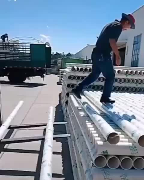 The way this guy rolls these pipes off a stack GIFs