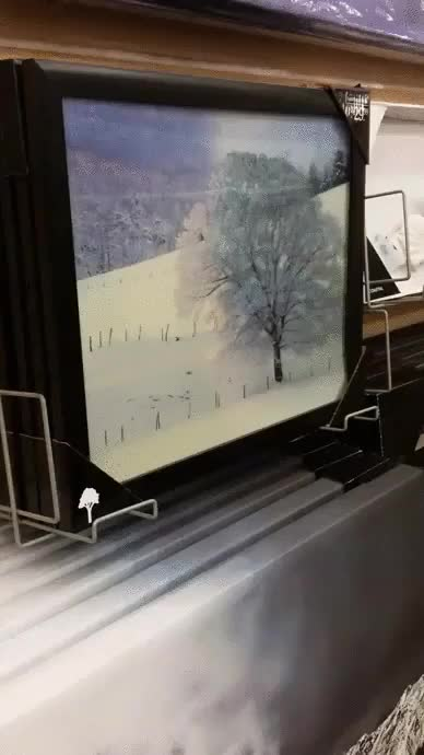 Watch and share Tin-foil-prints-shift-colors-from-different-angles GIFs on Gfycat