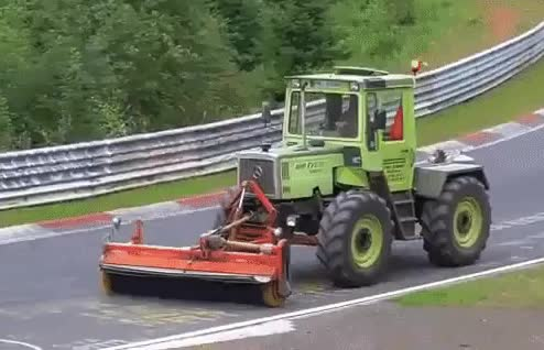 The effect of a tractor's tires being synchronized to a camera's shutter speed GIFs