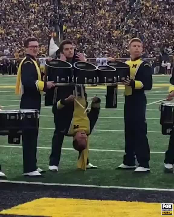 Watch and share Michigan Football Upside-down Drummer GIFs by wdeboer on Gfycat