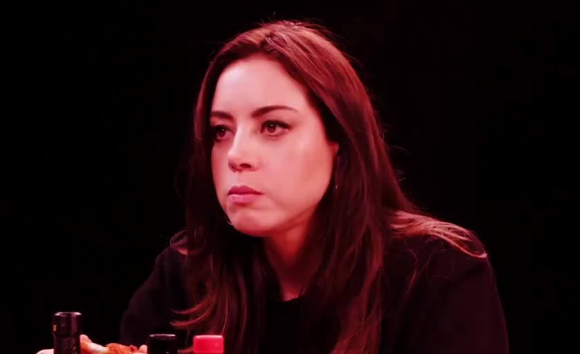 aubrey, bite, caliente, chew, chili, eat, hot, hurts, it, oh, omg, ones, ouch, pain, plaza, spice, spicy, tabasco, why, wings, Aubrey Plaza is in pain GIFs