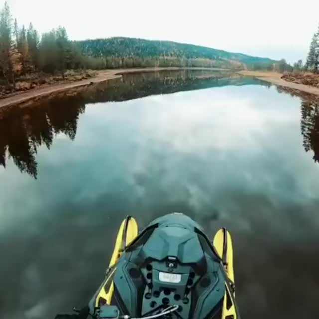 Watch and share Driving A Snowmobile On Perfectly Calm Water GIFs by MyNameGifOreilly on Gfycat