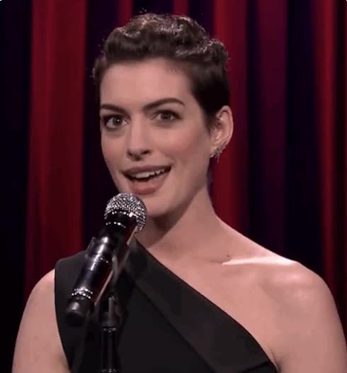 Watch and share Anne Hathaway GIFs and Wink GIFs on Gfycat