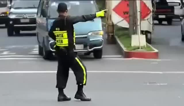 Watch and share Philippines Dancing Traffic Cop - Michael Jackson Style GIFs on Gfycat