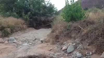 Watch and share Flash Flood Washes Across Utah Road GIFs on Gfycat