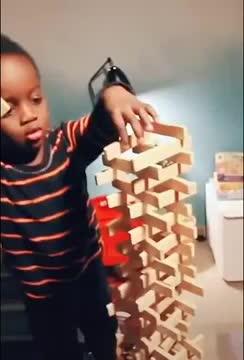 Watch and share Kid-looks-disappointed-after-stick-tower-gets-knocked-over-by-him-1136064 GIFs by rodrobong26 on Gfycat