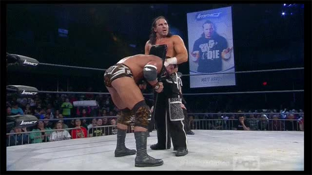 Twist of Fate with a Chair around EC3's neck