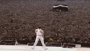 Watch and share Freddie Mercury Moves The Crowd At Live Aid GIFs on Gfycat