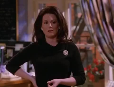 Watch and share Megan Mullally GIFs and Boobs GIFs on Gfycat