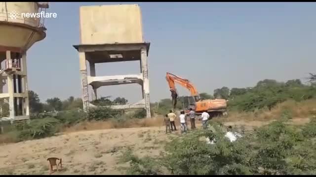 Watch Water tank being demolished falls on excavator GIF on Gfycat. Discover more related GIFs on Gfycat