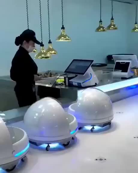 Robotic waiters in a restaurant