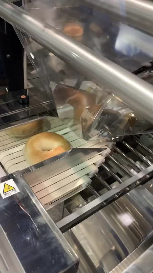 Watch and share Pack Expo Bagel Machine GIFs by immi on Gfycat