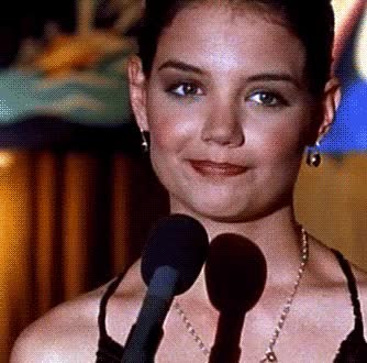 Watch and share Katie Holmes GIFs and Shrug GIFs on Gfycat