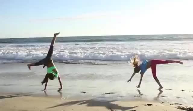 Watch and share Cartwheel GIFs and Beach GIFs on Gfycat