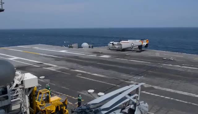 Watch and share U.S. Navy Lands A Drone On An Aircraft Carrier For The First Time GIFs on Gfycat