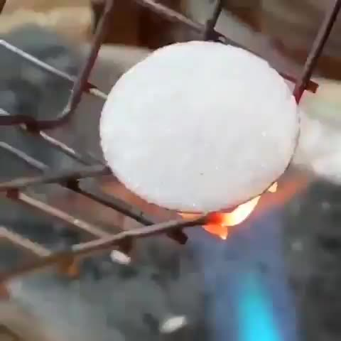 Watch and share Torch Firing Steel Under A Layer Of Finely Ground Glass In The Shape Of A Tsunami (@tkiplinger) GIFs by tothetenthpower on Gfycat