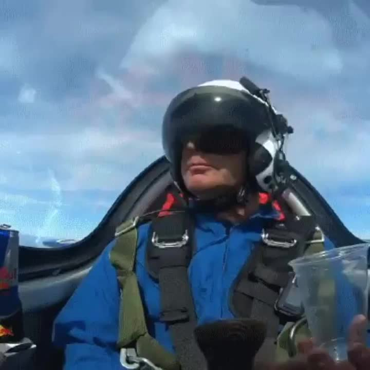 Pilot with a stylish way of pouring himself a drink GIFs