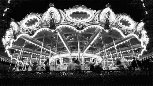 Watch You spin me round and round  GIF on Gfycat. Discover more Black and White, amusement park, carusel, round GIFs on Gfycat