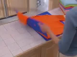 Watch and share How To Fold A Shirt GIFs on Gfycat