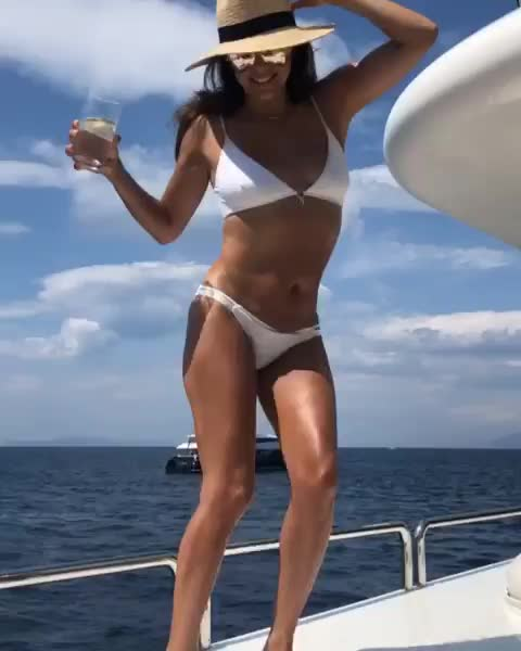 Super sexy Eva Longoria showing off tight amazing body dancing in a white bikini
