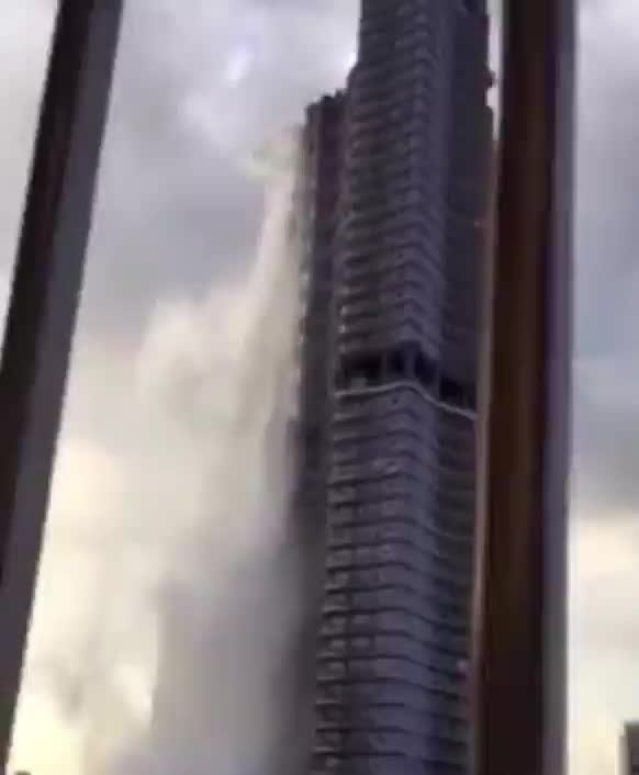 Rooftop pool on skyscraper in the Philippines cracks after a 5.6 earthquake, making a waterfall down the side of the building GIFs
