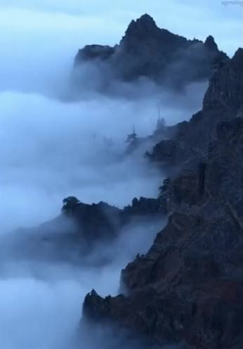 Watch and share Mountains GIFs and Foggy GIFs on Gfycat