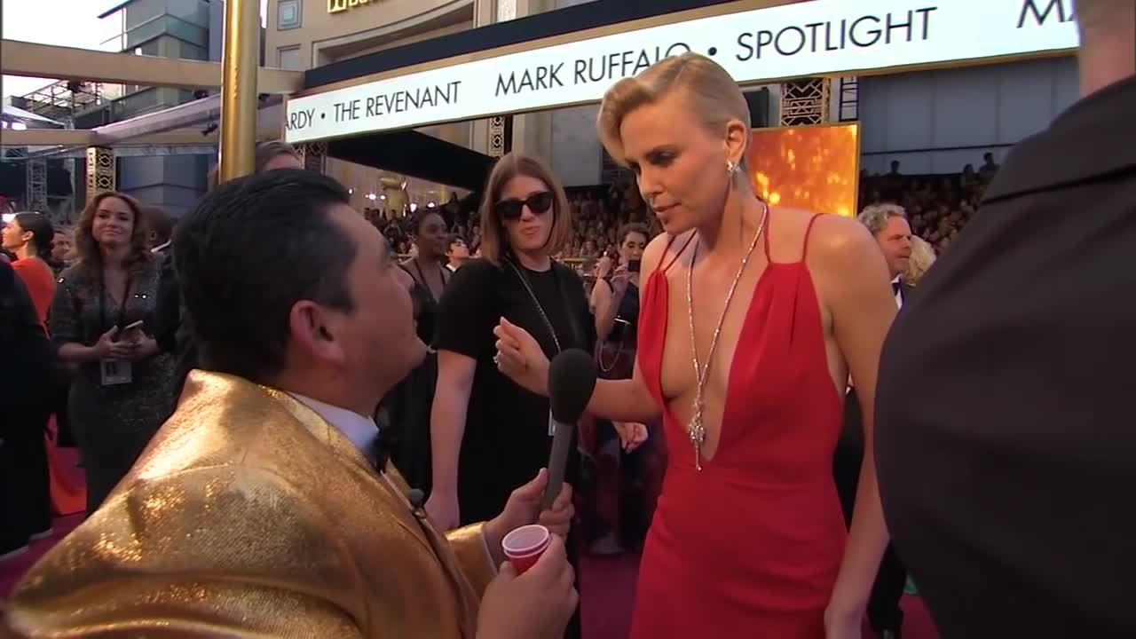 charlize theron, guillermo, jimmy kimmel, Guillermo on the 2016 Oscars Red Carpet - Charlize Theron GIFs