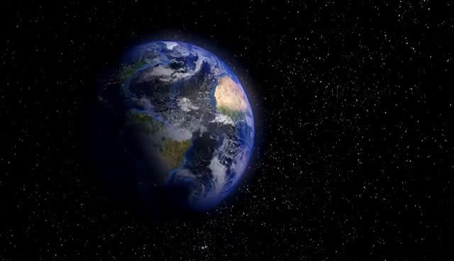 Beautiful planet earth rotating backwards into night HD GIF