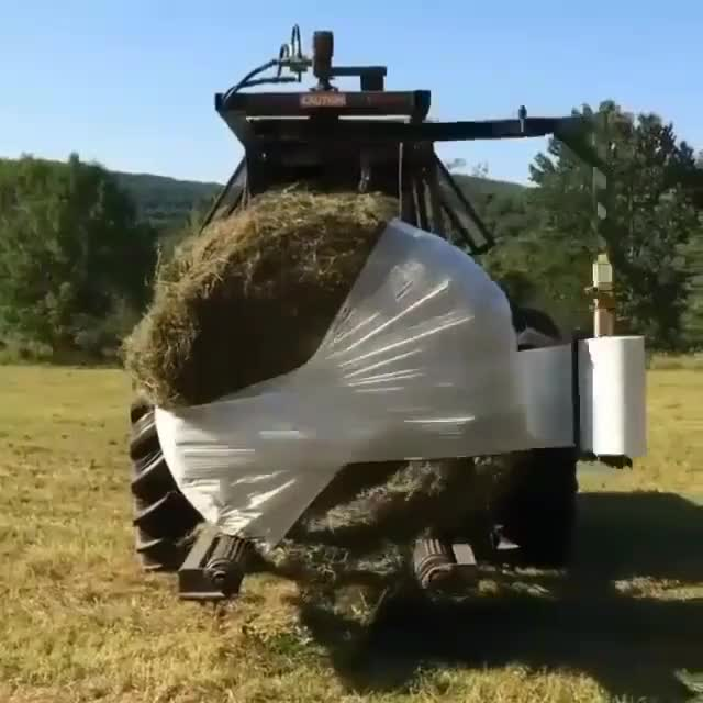 wrapping hay bales humanapproved GIF