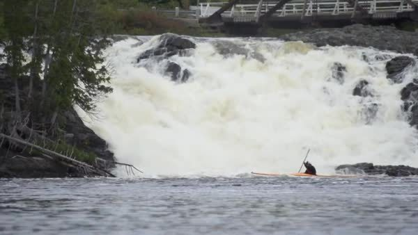 kayaking near waterfall GIFs
